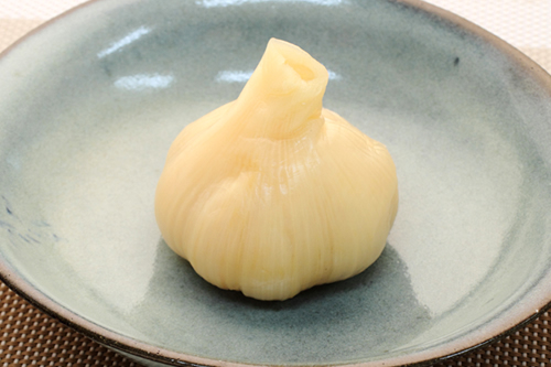 Sweet and sour pickled whole garlic